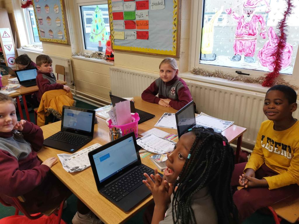 Ms Geraghty's class using the Chromebooks to type their Christmas Acrostic Poetry.